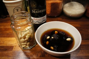 Almond-stuffed prunes soaking in Madeira wine
